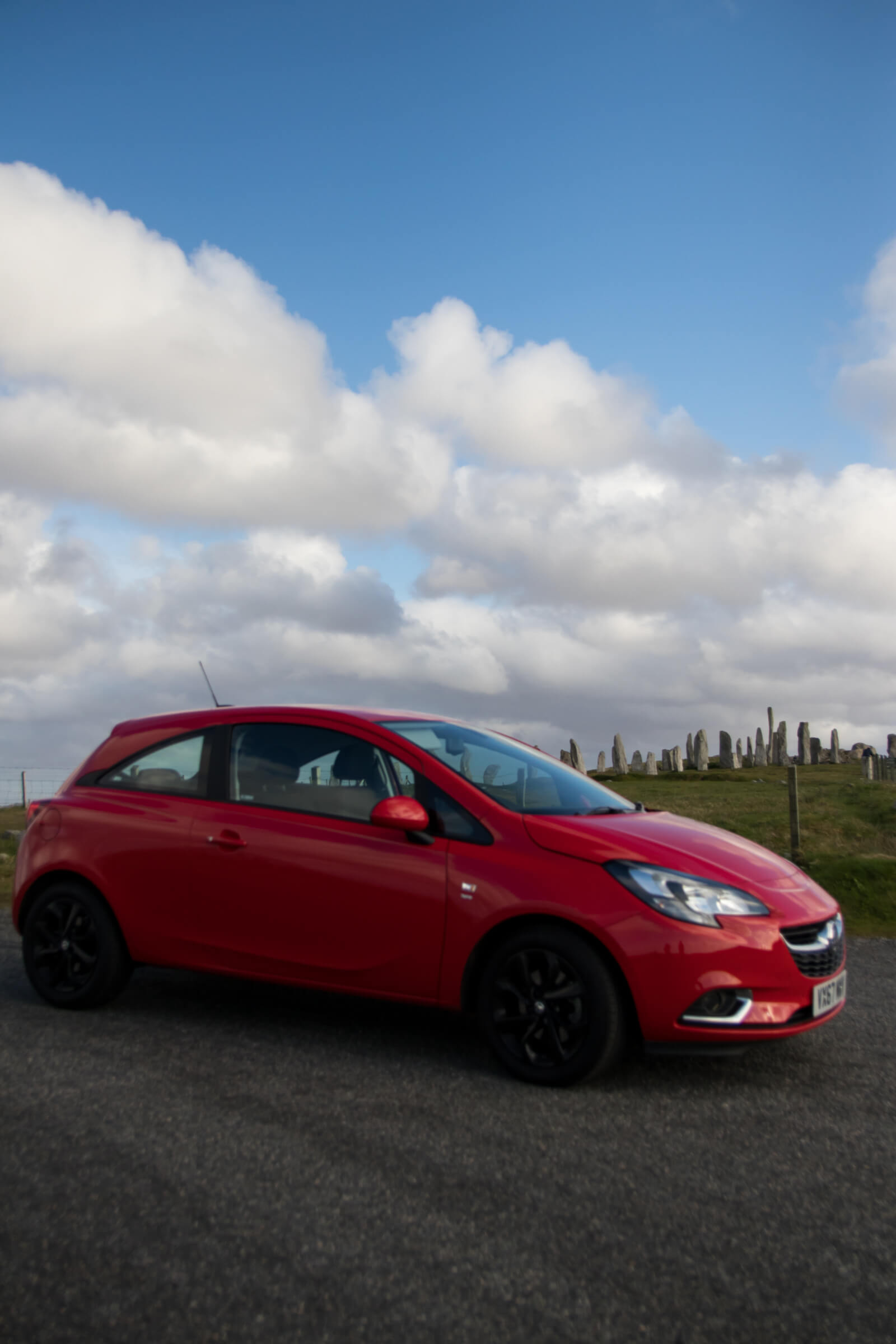 Red Vauxhall Corsa and Callanish Stones